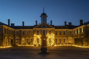 dark sky, Polesden Lacey exterior is illuminated
