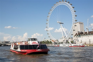 City Cruises boat on the river Thames passing the London Eye