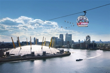 The O2 and skyscrapers behind a cable car travelling through the skyline