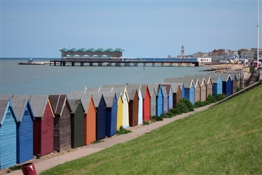 Colourful beach huts overlooking the sea in Herne Bay