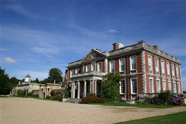 Large impressive stately home with six columns and steps at the entrance